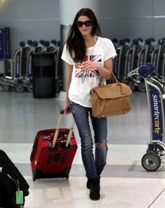 Ashley Greene touches ground at JFK airport in New York with her dog after arriving from Los Angeles.