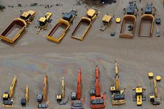 Heavy equipment is submerged in flood waters in an industrial area of Brisbane, Austrailia. Mining Equipment, Heavy Equipment, Tractor Decor, Earth Moving Equipment, Cat Machines, Magazine Pictures, Commercial Construction, Weather And Climate, Heavy Machinery