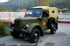 Romanian Army ARO (with canvas top cover and windows on). This was the last iteration of GAZ 69 clones, starting with the The was designed for mass production, and had a 70 hp engine Military Jeep, Military Vehicles, 4x4, Mass Production, Car Wheels, Old Cars, Romania, Cars And Motorcycles, Mammals