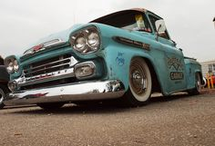 Rust in her race wears thin as a dime  my 58 Apache gets to work on time  it's 1958 heart rings true  and it's hard to tell the color, but it's always been blue