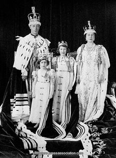 British Royal Family - Group Photographs - Coronation of King George VI - London - 1937  King George VI and Queen Elizabeth with their daughters Princess Elizabeth and Princess Margaret Rose after the Coronation of The Duke of York as King George VI.