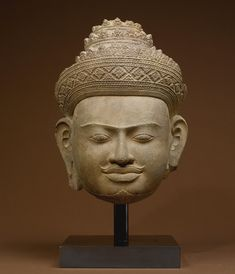Head of Vishnu Sandstone Khmer, early Pre Rup style height 13 in. (33 cm) 10th century