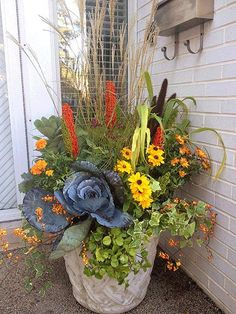 Just because the warmer months are gone, you don't have to give up the idea of color in your yard. Decorate your window boxes, planters, and containers, with gorgeous fall flowers, squash, gourds, pumpkins, and grasses. Bright displays of color and texture can keep the mood bright and cheery even if there is a crisp