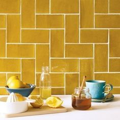 11 beautiful ways to use metro tiles 11 beautiful ways to use metro tiles While these Carnival Oro Tiles from Fired Earth would look lovely as part of an otherwise white scheme, we also love the idea of choosing a complementary botanical wallpaper. Kitchen Wall Colors, Kitchen Wall Tiles, Wall And Floor Tiles, Kitchen Flooring, Kitchen Backsplash, Diy Kitchen, Kitchen Decor, Fired Earth, Decorative Wall Tiles