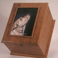 I am going to look for a photo box and do this for Addison and Snowflakes ashes.  So much nicer than the urn they are currently in...and I can add my favorite picture of them.