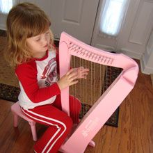 Pianos are not our only specialty. Here Megan plays her very own Schoenhut harp