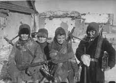 After the Battle of Stalingrad finished with the destruction of the German forces, these local boys found a literal treasure trove of abandoned weapons and equipment. Here they posed for the camera carrying ammo belts, ammo boxes, machine guns and rifles, all German. February 1943. Ordnance strewn over the battlefield remained a real hazard well into the 1960s.