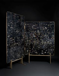 Marcin Rusak - Flora screen - Selected and dried flowers cast in black resin panels and sliced. Handmade brass structure and cast brass legs.
