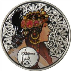 Libra silver coin, with the art of Alfons Mucha
