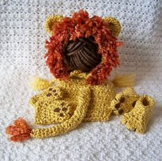 Ravelry: Lion Paws Booties and Mittens pattern by Carolyn VanOstran