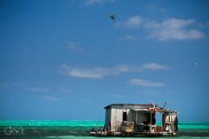 Fishing shack in the middle of the sea near Ambergris Caye, Belize.  Photographers Del Sol Photography