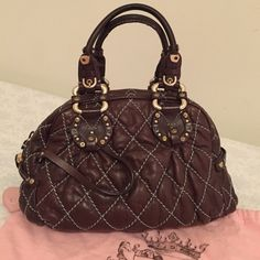 Juicy Couture Hand Bag Juicy couture hand bag, dark brown , gentle used. Interior is so roomy. There are 2 open pockets and 1 zipper pocket. Juicy Couture Bags