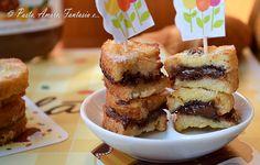 Buongiorno a tutti! Oggi vi propongo un dolcetto veloce e sfizioso: la Nutella in Carrozza. Pane e Nutella, fritto, che si può eventualmen