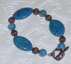 Denim Lapis in flat ovals and rounds enhanced with copper beads and toggle clasp. Bracelet measures just about 8 and nicely fits a to 7 inch wrist. Etsy Jewelry, Jewelry Shop, Jewelry Stores, Unique Jewelry, Copper Bracelet, Turquoise Bracelet, Real Pearls, Swarovski Pearls, Bead Earrings