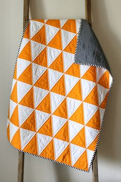 A few quilts. Isosceles triangle quilts. They are happy, pleasing to my eye, simply sophisticated, yet playfully sweet. I could make one in every color of the rainbow... 'Cause that's how