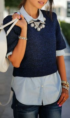 Layer a rolled up button down with a short sleeve sweater for cute and warm, casual look.