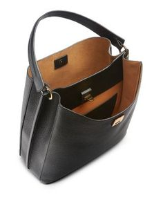 Gilded turnlock hardware adorns Mcm's minimalist yet luxurious tumbled leather hobo which features a roomy, well-organized interior and optional shoulder strap.