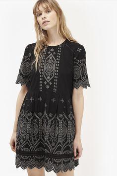 "<ul> <li> Cotton babydoll summer dress with Broderie Anglaise</li> <li> Graphic ladder lace inserts and scallop edges</li> <li> Round neck</li> <li> Elbow-length sleeves with scalloped trim</li> <li> Eyelash trim at hem</li> <li> Easy fit</li> <li> UK size 10 length is 86.2cm</li> </ul>  <strong>Our model is 5ft 10"" and is wearing a UK size 10.</strong>"