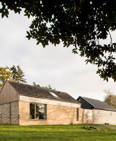 Brickwork, cedar cladding, shingles and Velfac glazing at the Stables. McLean Quinlan