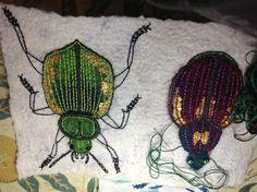 Felted and embellished jewel beetles by Helen Richardson