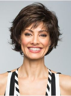 The Adelle Synthetic wig by Revlon is an easy shakeandgo style that features razored edges creating a modern trendy look is part of Thick hair styles - Short Hair With Layers, Short Hair Cuts For Women, Layered Hair, Short Cuts, Medium Hair Styles, Curly Hair Styles, 40 Year Old Hair Styles, Short Haircut, Pixie Haircut