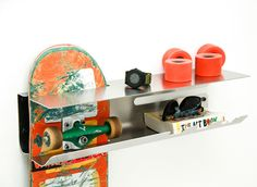 A Wall Mounted Rack to Proudly Display Your Skateboard Photo