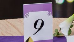 Purple and white wedding table number
