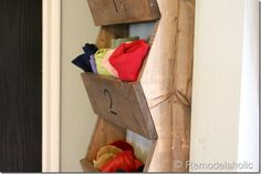 Mount bins on the wall to store underwear, scarves, hats, etc. This can be super creative and pretty cheap without taking much time out of your schedule.