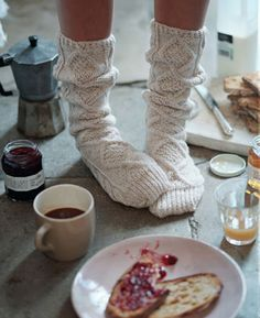 cozy socks, toast with jelly, orange juice