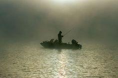 Fisherman on a foggy morning in Georgia.