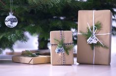 Simple wrapped presents. Added small silver ornaments for the little extra something.