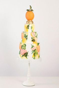This fresh-looking citrus-patterned cake was painted by hand and finished with a handcrafted orange finial. | Nadia & Co.