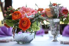 Pretty pink and coral floral arrangements in mercury glass vases. Laurel Designs, San Francisco