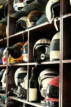 Maybe a good way to store and display customers' motorcycle helmets while their bikes are being worked on in the service department. Cafe Racers, Buick Wildcat, Helmet Head, Vintage Helmet, Scrambler Custom, Vintage Cafe Racer, Pinstriping, Motorcycle Helmets, Motorcycle Garage