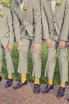 Groomsmen wear socks with wedding colors but turquoise