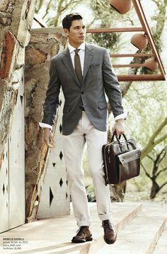 — Dark Green Print Pocket Square — Olive Tie — White Dress Shirt — Grey Blazer — Dark Brown Leather Briefcase — Beige Chinos — Dark Brown Leather Derby Shoes