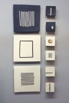 Black and White by Lori Katz. Slab built stoneware with *slips:slip*, underglaze, glaze, metal leaf. Backed on wood and wired to hang on picture hooks. Easy to use hanging template included. template included