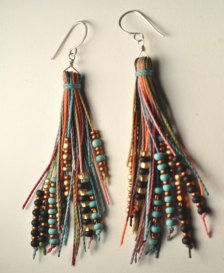 these playful and colorful earrings are my take on the popular feather earrings! a tassle of color mixed with a variety of glass beads, these earrings dangle and dance! available in many different colors! email me with you color preference. hand formed and hammered sterling silver or hand hammered antique brass ear wires (nickel free and hypoallergenic).  approximately 3 long. length does vary with each pair. please specify if you would prefer a longer or shorter pair.