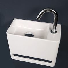 Compact fonteintje voor toilet bg. Mooi en geen scherpte hoeken waar je je aan kunt bezeren.