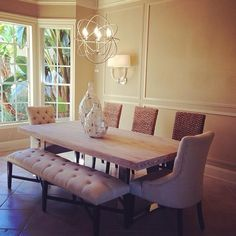 @nicolecostafitness snapped a photo of her dining room, featuring our Rencourt Tufted Bench, Marseilles Dining Chairs, Hyacinth Chairs, Tempest Vases, & Eclipse Chandelier.