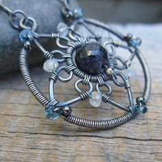 Wire wrap star pendant with gemstones.