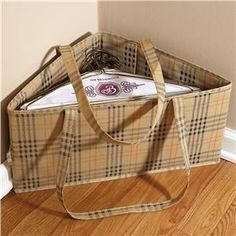 Hanger Bins --- To DIY this, just find a square box big enough to hold the hangers and divide it down the diagonal with a piece of cardboard so it stays organized even when the stacks are uneven..