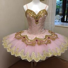 "NEW EXCLUSIVE 2015 STYLE! This professional tutu is perfect for the role of Gamzatti in ""La Bayadere"" but also for other ballets like ""Paquita"", ""Raymonda"", Sleeping Beauty, Sugar Plum Fairy, and many other. The bodice is created in shiny stretchy pink brocade, featuring a deep V cut in the front. The decoration on the bodice is just amazing: gold appliques, trims and crystals, red and pink Swarovsky crystals make this bodice more than regal. The pale pink  prof..."