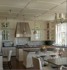 Cream Painted Cabinets, Zinc Countertop, book-matched marble backsplash, library ladder in Kitchen, pendant lights, butcherblock countertop
