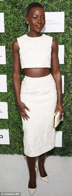 Best dressed @ 2014 Essence Black Women luncheon | Lupita Nyong'o in a Giambattista Valli white ensemble featuring a crop top, pencil skirt & Sophia Webster matching pumps styled with a gold hair band & a box clutch