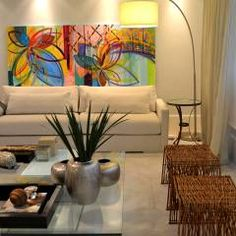 Apartamento para um jovem casal em tons de cinza: Salas de estar Moderno por Helô Marques Associados