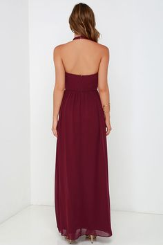 Make a stunning debut on the dance floor or in the ballroom, with the Ooh Gala-La Burgundy Maxi Dress! Burgundy chiffon shapes a high, halter neckline that fastens at back with a two-button closure and bit of elastic for fit. Keyhole accents the front of the lightly padded, pintucked bodice with hidden boning, while a sweeping maxi skirt falls effortlessly from a fitted, empire waist. Hidden zipper/hook clasp at back. Fully lined. Self: 100% Polyester. Lining: 95% Polyester, 5% Spandex. ...