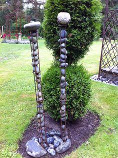 pebble & stone holders made by Margaret for her garden in Rørvig, Denmark  -- via jernihaven