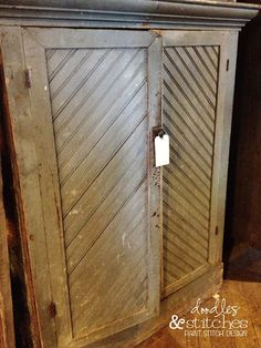 I love this old antique cabinet with cool wooden chevron design!  It's at west end salvage
