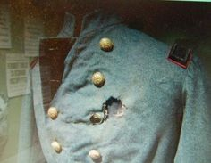 Gunshot uniform of Colonel Elmer Ellsworth, a 24-year old law-clerk and a friend of President Abraham Lincoln. Sent to Alexandria, Virginia, on 24 May 1861, the day after Virginia voted for secession - Ellworth was killed while removing a Confederate flag.  He was the first Union officer to die in the war.  Note the faded wool, the result of removing the bloodstains.